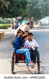 Taxi bike is carrying a woman with children.Public transport of India. India, Govardhan, November 2016