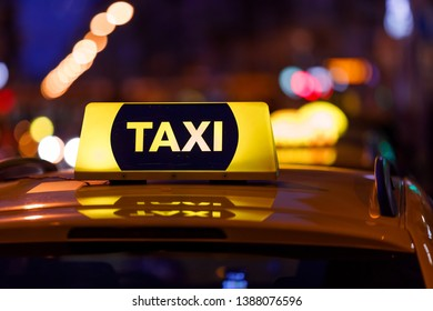 taxi and blurred city lights at night