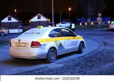 Taxi car at night in waiting for customers, the company Yandex taxi. Crocus Vegas Mall . Moscow. 26.10.2018