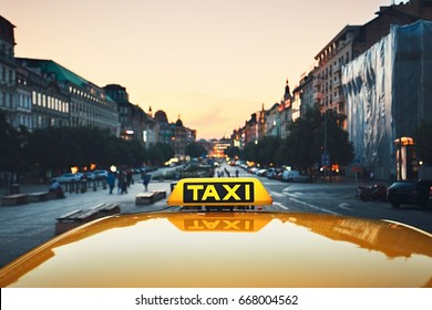 Taxi car on the city street at dusk.  Wenceslas Square, Prague, Czech Republic