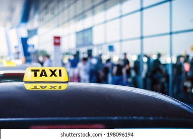Taxi car waiting arrival passengers in front of Airport Gate