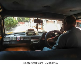 Taxi driver in busy traffic in Calcutta , India. Photo taken in  October 2011