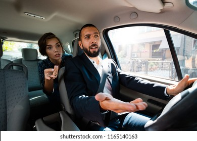 Taxi driver driving a car and having an argument with female passenger.
