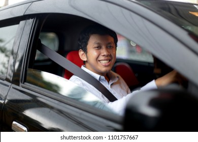 taxi driver man face asian male. uber driver asian man smiling. yogyakarta indonesia. may 31, 2018