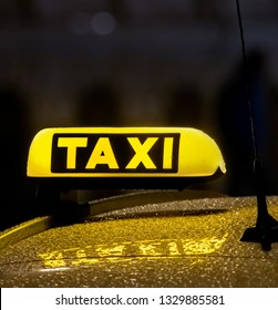 taxi lights on rainy night drive home safety