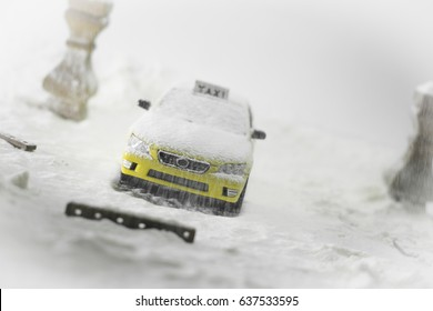 Taxi miniature under the snow