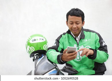taxi motorcycle driver gojek, uber and grab from asian transportation. march 19, 2018. Yogyakarta Indonesia.