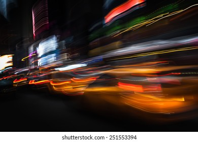 Taxi at night in New York City. Illumination and night lights of New York City. Intentional motion blur