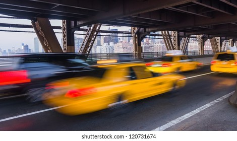 taxi on Queensboro Bridge and New York City Manhattan on background