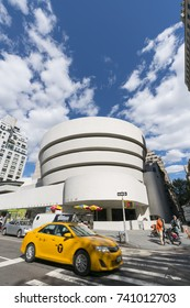 Taxi runs at front of TheSolomon R. Guggenheim Museum at Fifth Avenue Upper East Manhattan New York, NY, USA on May. 03 2017.