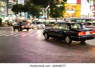 Taxi at shibuya crossing, Shibuya, Tokyo, Japan, 25-09-2014