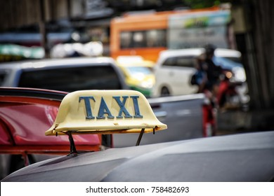 Taxi sign on the car in thailand