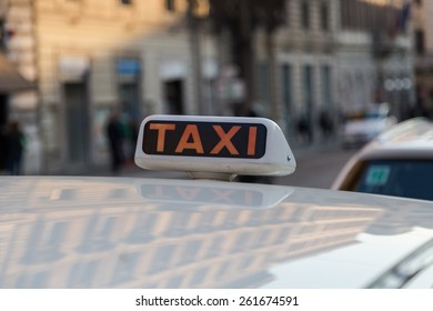 Taxi Sign on a Taxi in Rome