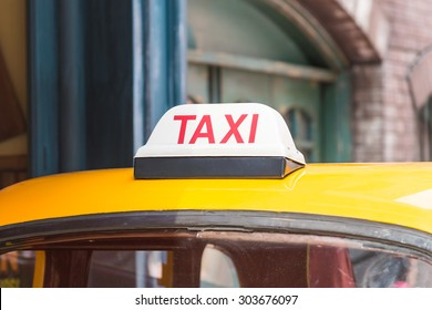 Taxi sign on roof top car