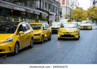 Taxi station, yellow taxi vehicles on the street