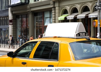 Taxi top advertising. Billboard display on yellow cab.