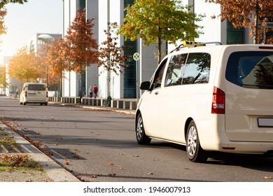 Taxi van on the city street