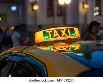 Taxi is waiting for the clients in the city center