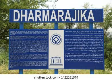 Taxila, Pakistan - December, 2018: Dharmarajika Stupa Map instructions Board at entrance in Taxila Pakistan, The Great Stupa of Buddhist Religion, built to house small bone fragments of Buddha