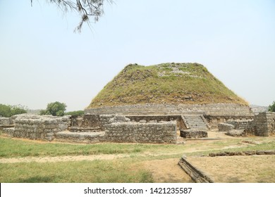 Taxila, Pakistan - December, 2018: View of Dharmarajika Stupa Remains in Taxila Pakistan, The Great Stupa of Buddhist Religion, Dates from 2nd century CE built to house small bone fragments of Buddha