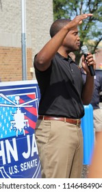 Taylor, MI/USA: July 29, 2018 – Republican Candidate for Senate in Michigan John James speaks at an outdoor campaign rally. He is a former Army Captain and West Point graduate.