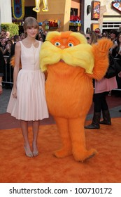 "Taylor Swift and Lorax at the ""Dr. Seuss' The Lorax"" Premiere, Universal Studios, Universal City, CA 02-19-12"