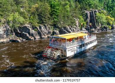 TAYLORS FALLS, MN/USA - SEPTEMBER 8, 2018: Unidentified people aboard the Taylors Falls Princess river boat on the St. Croix River at Interstate Park.