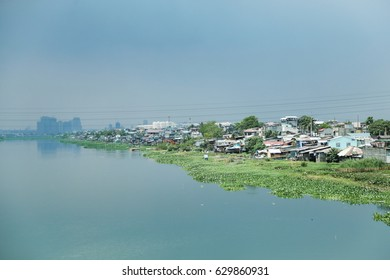 TAYTAY, PHILIPPINES - MARCH 15: The Manggahan Floodway remains plagued by informal settlers, sewage, and water hyacinth, as seen from the Barkadahan Bridge in Taytay, Philippines on March 15, 2016.