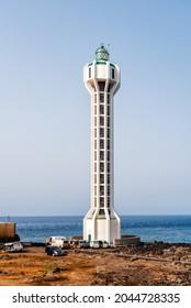Tazacorte, Spain - August 15, 2021: Punta Lava Lighthouse in La Palma. La Bombilla, Tazacorte, Canary Islands. Los Guirres Beach. It is located on a volcanic lava field