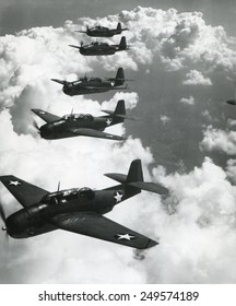 TBF Avengers flying in formation over Norfolk, Va. Photo by Lt. Comdr. Horace Bristol, who became a noted photographer after the war.Sept. 1942.
