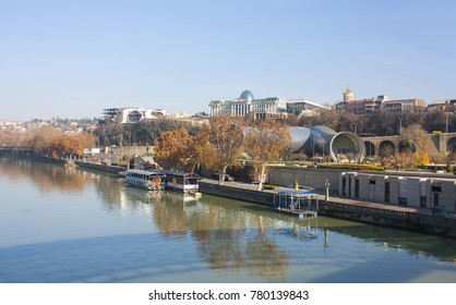 Tbilisi - December 16, 2017. Embankment overlooking the government building and concert hall near the Peace Bridge in Tbilisi, Georgia