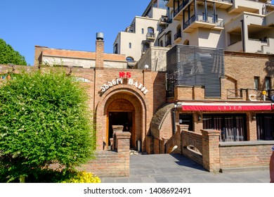 Tbilisi / Georgia - 05.16.2019: Abanotubani is the ancient district of Tbilisi old town, known for its sulfur baths. Entry in public sulphur baths № 5
