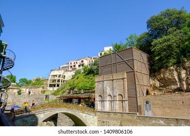 Tbilisi / Georgia - 05.16.2019: Sulfur baths in the Abanotubani district of Tbilisi old town.