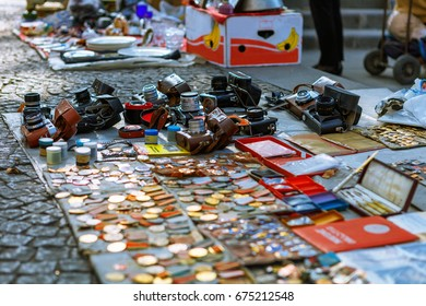 Tbilisi, Georgia - 08 October, 2016: Stall of Soviet badges and icons, vintage retro photo cameras sold in Dry Bridge Flea market. Dry bridge today is most famous flea market in Georgia.