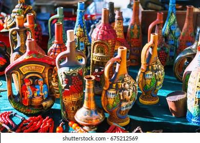 Tbilisi, Georgia - 08 October, 2016: Dry Bridge Flea market in Tbilisi sells, tableware set, dishes, souvenir georgian Clay jugs, pottery. Most famous flea market in Georgia.