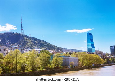 Tbilisi, Georgia - 19 April, 2017: Panorama view of Tbilisi. Modern landmark - Biltmore Hotel Tbilisi and a view on Kura river