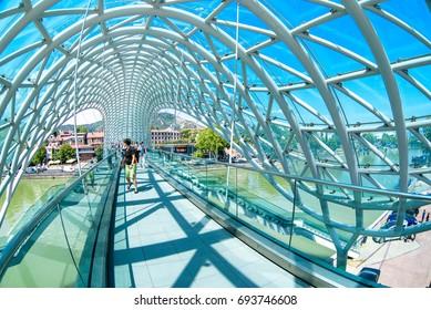 TBILISI, GEORGIA -  26, July 2017: The Bridge of Peace is pedestrian bridge over the Kura River in Tbilisi, capital of Georgia. The bridge is one of the new symbols of Tbilisi.