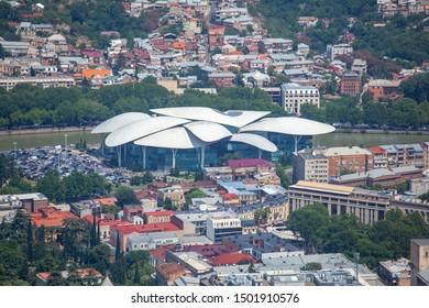 Tbilisi, Georgia - 30.07.2019: Beautiful aerial view of Tbilisi city center, Public Service Hall, from Mtatsminda Park. Travel.