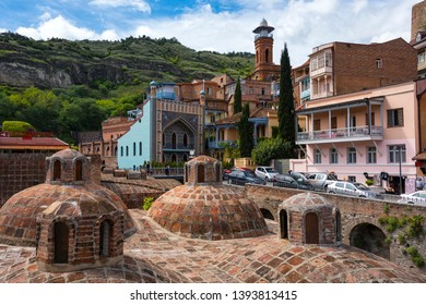 TBILISI, GEORGIA, 5 MAY, 2019: Architecture of the Old Town of Tbilisi, Georgia, in Abanotubani area. Domes of sulfur baths, Jumah mosque and carved balconies in the picture. Horizontal orient.