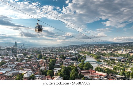 Tbilisi, Georgia: Aerial panoramic view from Narikala Fortress, aerial cable car, old town, modern architecture (Bridge of Peace, Fuksas music theatre exhibition hall), Kura river, Rike Park