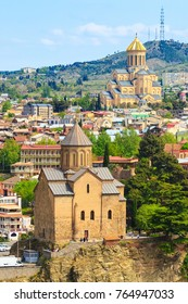 Tbilisi, Georgia aerial skyline with Metekhi and Tsminda Sameba churches