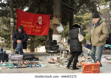 TBILISI, GEORGIA . Antique sell on the flea market Dry Bridge with buyers of art, old utensils and retro souvenirs.2/4/2017.