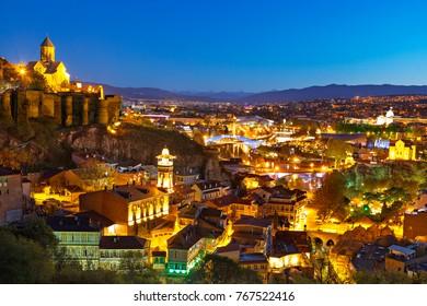 TBILISI, GEORGIA - APRIL 20, 2017: Night view over Tbilisi, at twilight, capital of Georgia, in Tbilisi, Georgia.