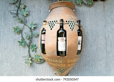 Tbilisi, Georgia - April 25, 2017: Decorative display case in the form of kvevri container with wine bottles in it