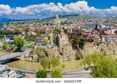 Tbilisi, Georgia - April  26, 2019: Panoramic view of Tbilisi city from Sololaki Hill, old town and modern architecture.