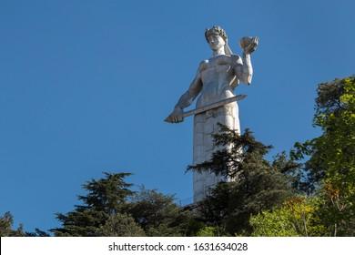 TBILISI, GEORGIA - APRIL 27, 2019: Monument Kartlis Deda (Mother Of Georgia) on Sololaki hill, Tbilisi, Georgia. Female figure with wine bowl and sword