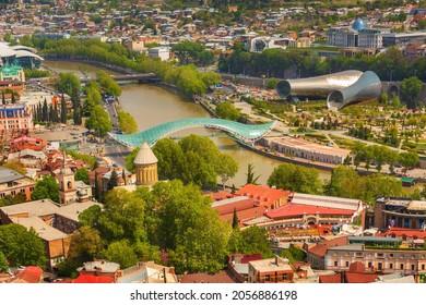 Tbilisi, Georgia - April 29, 2017: Aerial skyline with river, Bridge of Peace, panoramic view