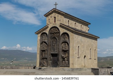 TBILISI, GEORGIA - APRIL 29, 2019: Annunciation Church on a hill near Tbilisi next to the monument Chronicles of Georgia