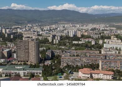 TBILISI, GEORGIA - APRIL 29, 2019: Aerial view on suburbs and old living blocks of Tbilisi, Georgia