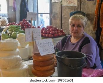 TBILISI, GEORGIA - April 30, 2014: Woman seller of traditional georgian cheese. Farmer market in old town Sololaki, Tbilisi.